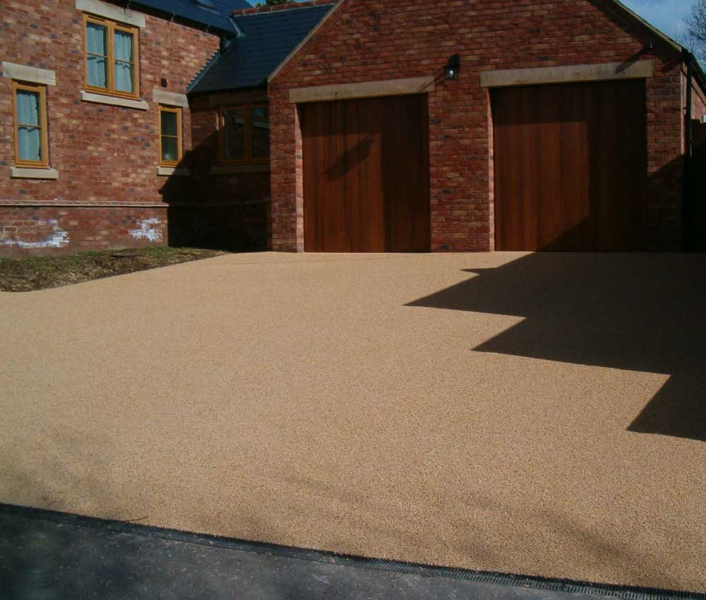 Resin Bound Gravel Driveway With Garage Doors